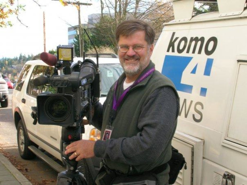 Photo - This undated photo released by KOMO-TV shows former longtime KOMO photographer Bill Strothman. A KOMO-TV helicopter crashed into a city street near Seattle's Space Needle, Tuesday, March 18, 2014, killing Strothman and pilot Gary Pfitzner, and critically injuring a person in a car on the ground.(AP Photo/KOMO-TV)