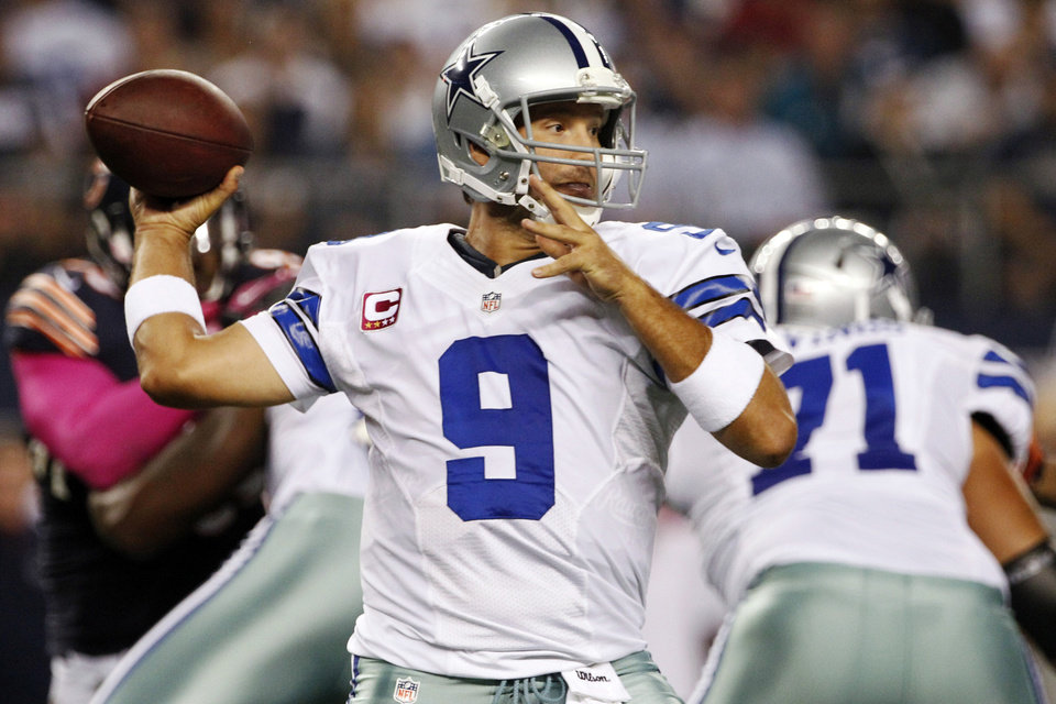 Photo -   Dallas Cowboys quarterback Tony Romo (9) passes the ball against the Chicago Bears during the first half of an NFL football game, Monday, Oct. 1, 2012, in Arlington, Texas. (AP Photo/Tony Gutierrez)