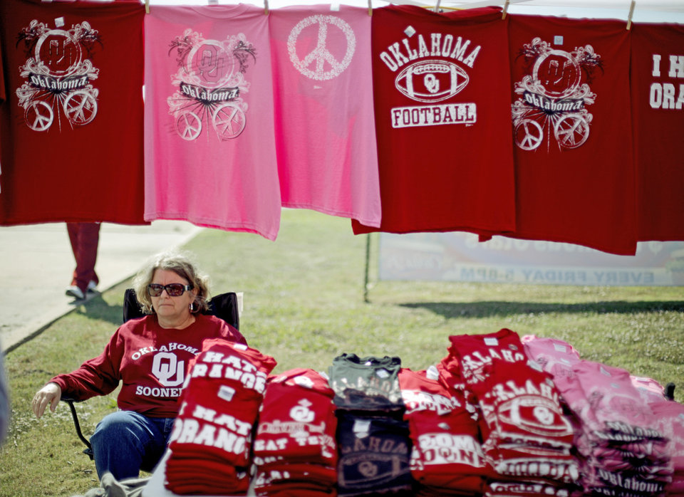 Photo - Sharon Claytor of Ardmore, Okla., sits under a tent that sells OU apparel during Bevo Bash in Marietta, Okla., on Friday, October 16, 2009. Photo by Bryan Terry, The Oklahoman ORG XMIT: KOD