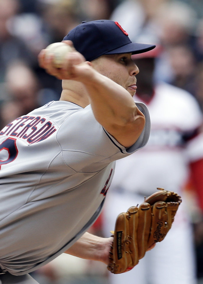 Photo - Cleveland Indians starter Justin Masterson throws against the Chicago White Sox during the first inning of a baseball game in Chicago on Saturday, April 12, 2014. (AP Photo/Nam Y. Huh)