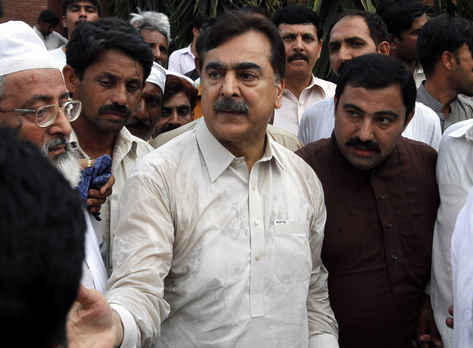Photo - People visit Pakistan's former Prime Minister Yousuf Raza Gilani, center, at his residence in Multan, Pakistan, Thursday, May 9, 2013. Gunmen attacked an election rally in Pakistan's southern Punjab province on Thursday and abducted Ali Haider Gilani,  son of a former prime minister, intensifying what has already been a violent run-up to Saturday's nationwide elections. (AP Photo/Zeeshan Hussain)