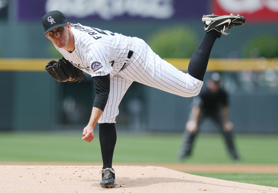 Photo - Colorado Rockies starting pitcher Christian Friedrich works against the Milwaukee Brewers in the first inning of a baseball game in Denver, Saturday, June 21, 2014. (AP Photo/David Zalubowski)