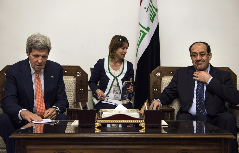 Photo - Iraqi Prime Minister Nouri al-Maliki, right, meets with U.S. Secretary of State John Kerry, left, at the Prime Minister's office in Baghdad, Iraq, Monday, June 23, 2014. Kerry is visiting Iraqi leaders to discuss the increasing violence and instability in country caused by insurgents including the al-Qaida-inspired Islamic State of Iraq and the Levant. (AP Photo/Brendan Smialowski, Pool)