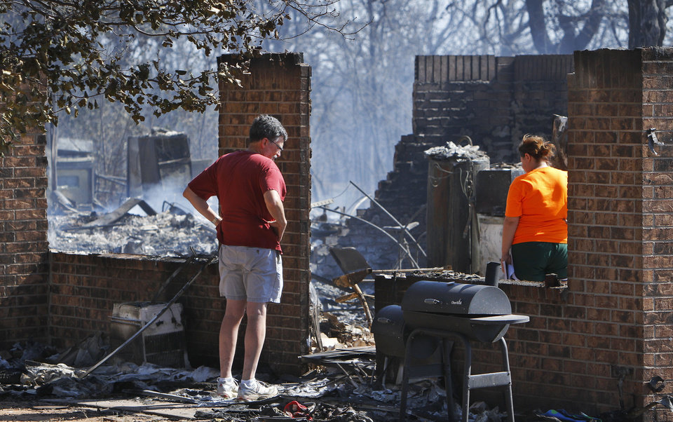 Residents of Luther return to their homes in August after they fled a rapidly moving wildfire.  Photo by Jim Beckel, The Oklahoman Archives