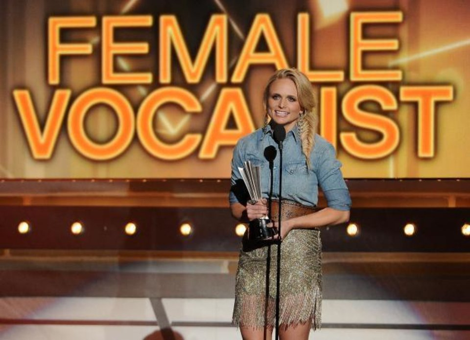 Photo -  Miranda Lambert accepts the award for female vocalist of the year at the 49th annual Academy of Country Music Awards at the MGM Grand Garden Arena on Sunday, April 6, 2014, in Las Vegas. (AP)