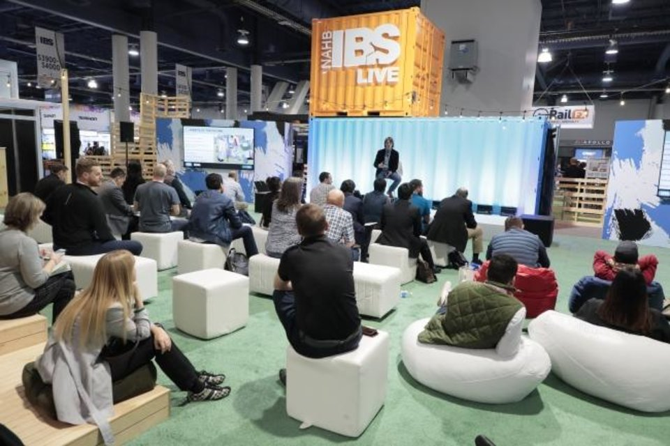 Photo -  People listen to a presentation at the International Builders Show. [OSCAR EINZIG PHOTOGRAPHY]