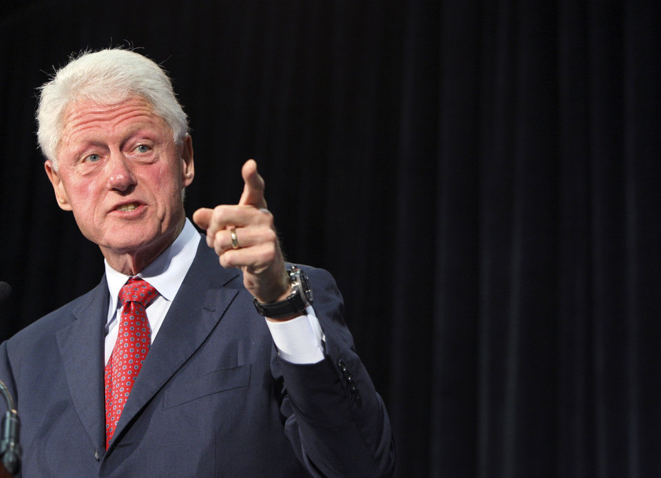 Former President Bill Clinton gestures as he speaks at Florida International University, Tuesday, Sept. 11, 2012 in Miami, as he campaigns for President Barack Obama. (AP Photo/Wilfredo Lee)