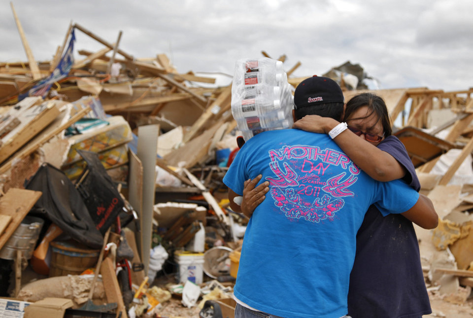 Susan Sleeper is hugged by family friend Fred Allrunner outside what use to be her home west of El Reno, Okla., Wednesday, May 25, 2011. Photo by Chris Landsberer, The Oklahoman