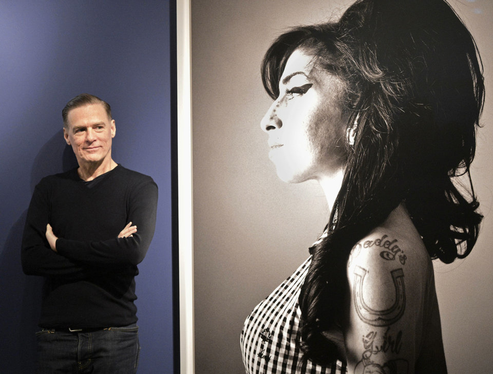 Canadian rock star Bryan Adams stands beside of one of his photo prints showing British singer Amy Winehouse during the opening of his exhibition in Duesseldorf, Germany, Friday, Feb. 1, 2013. Adams shows 150 pictures of his photo work like celebrity portraits, but also a series of portraits of injured soldiers coming home from Iraq and Afghanistan. (AP Photo/Martin Meissner) ORG XMIT: MME101