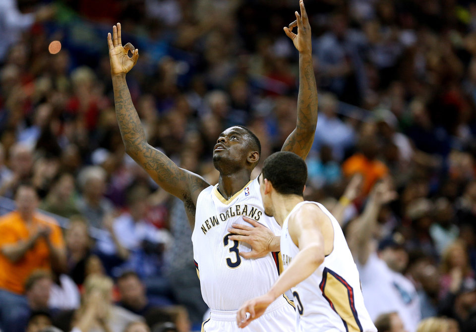 Photo - New Orleans Pelicans guard Anthony Morrow (3) celebrates after scoring during the second half of an NBA basketball game against the Miami Heat in New Orleans, Saturday, March 22, 2014. The Pelicans won 105-95. (AP Photo/Jonathan Bachman)