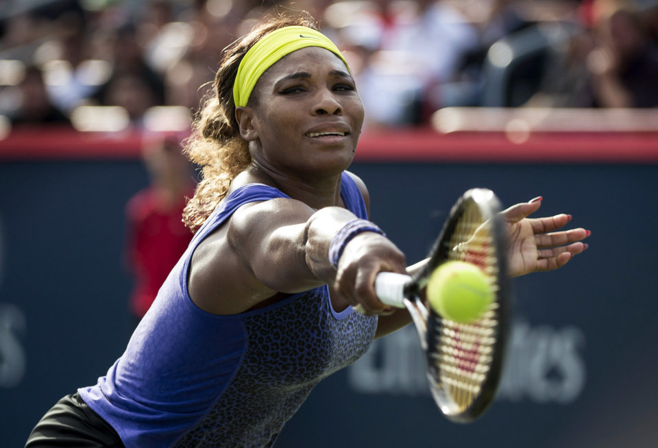 Photo - Serena Williams ,of the United States returns the ball to Lucie Safaroa, of the Czech Republic, at the Rogers Cup tennis tournament, Thursday, Aug. 7, 2014, in Montreal. (AP Photo/The Canadian Press, Paul Chiasson)