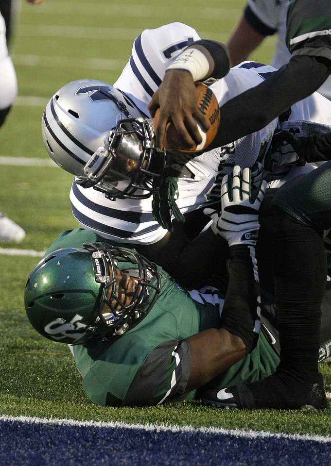 Edmond North\'s Michael Farmer reaches for a touchdown as Edmond Santa Fe\'s Carlos Washington defends during high school football game between Edmond Santa Fe and Edmond North at Wantland Stadium in Edmond, Okla., Friday, Sept. 14, 2012. Photo by Sarah Phipps, The Oklahoman