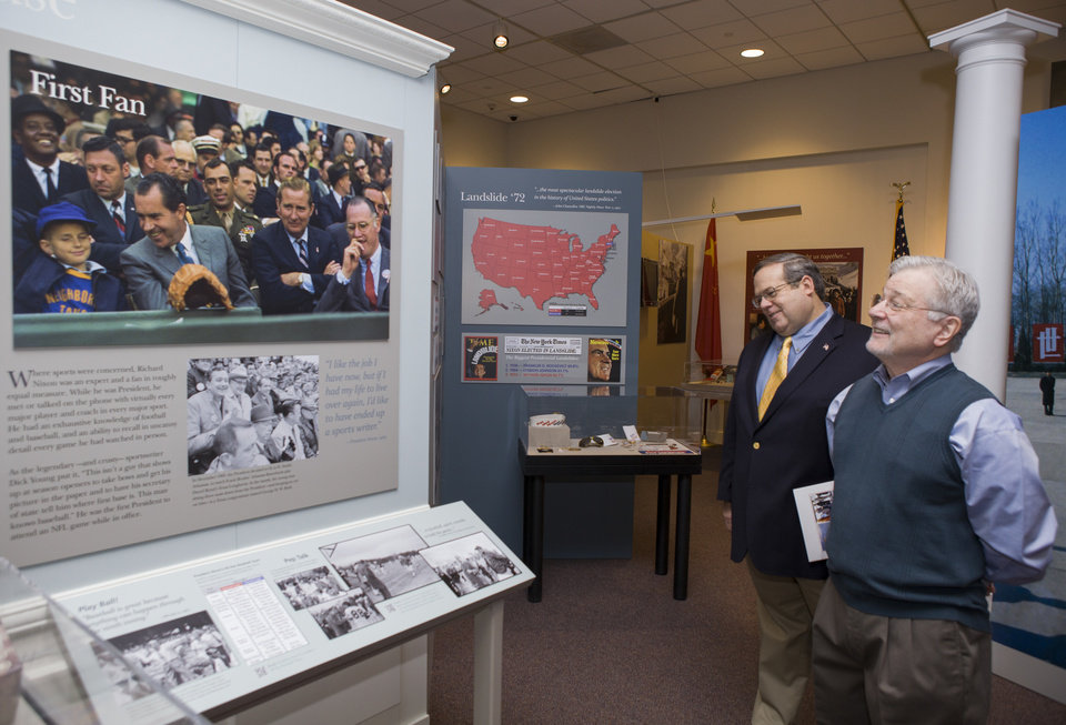 Photo - In this Tuesday, Feb. 12, 2013 photo, curator Bob Bostock, a former Nixon aide who designed the original Watergate exhibit, left, and co-curator Frank Gannon,  tour the new exhibit: