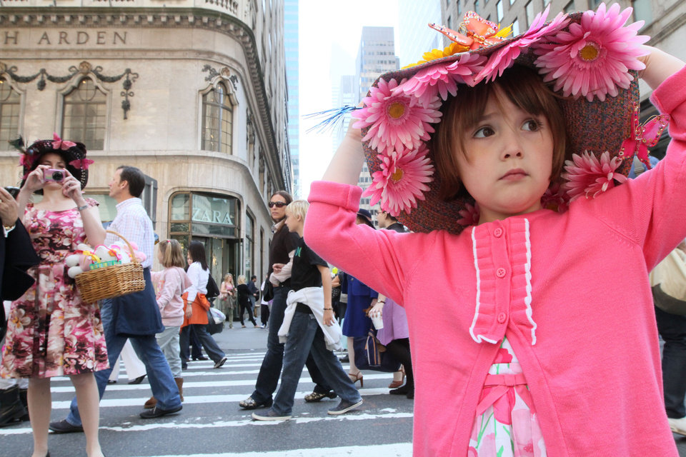 Photo -   **CORRECTS SPELLING** Julia Scotti, 4, of Fairlawn, N.J., right, adjusts her hat as she and her mother Regina Scotti, left, take part in the Easter Parade along New York's Fifth Avenue Sunday April 24, 2011. (AP Photo/Tina Fineberg)