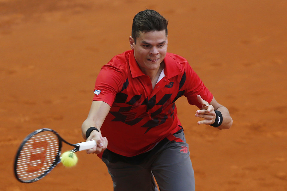 Photo - Milos Raonic from Canada returns the ball during a Madrid Open tennis tournament match against Jeremy Chardy from France, in Madrid, Spain, Tuesday, May 6, 2014. (AP Photo/Andres Kudacki)