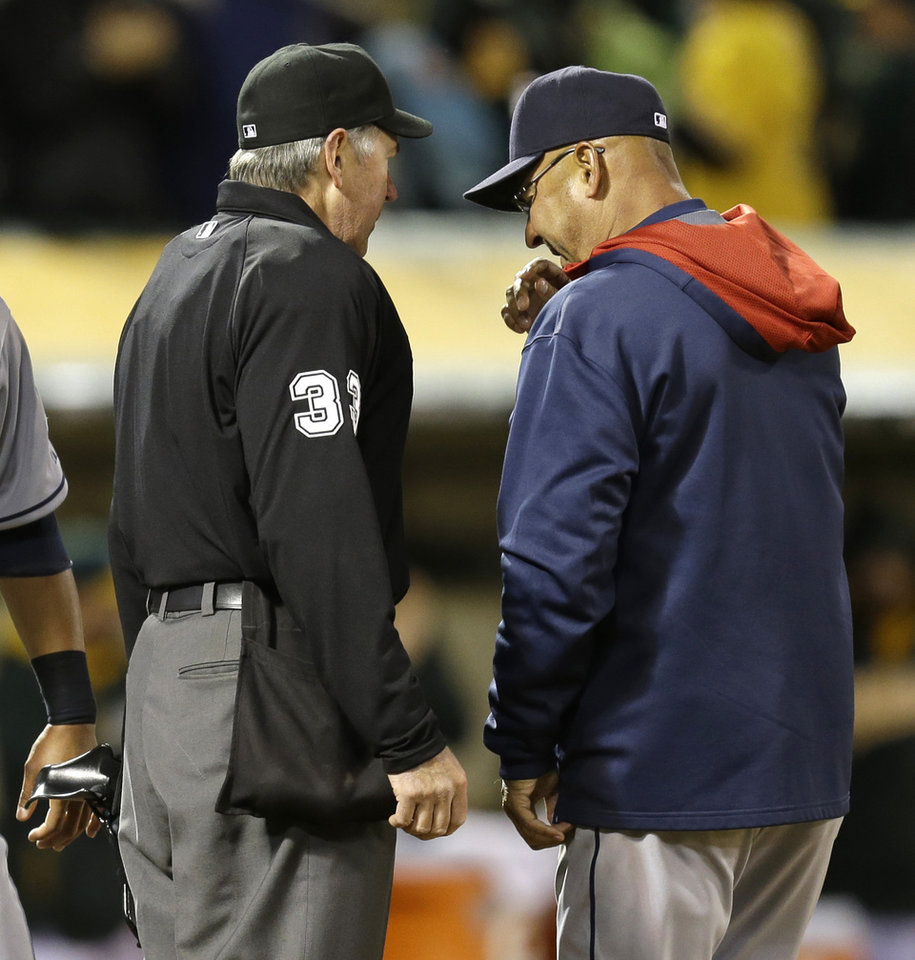 Photo - FILE - In this March 31, 2014 file photoi, Cleveland Indians manager Terry Francona, right, contests a play at the plate with umpire Mike Winters in the sixth inning of a baseball game against the Oakland Athletics in Oakland, Calif. With baseball's expanded replay rule this season, those colorful, saliva-trading tirades Bobby Cox and Lou Piniella made famous could very well be replaced by far more civilized behavior.  (AP Photo/Ben Margot, File)