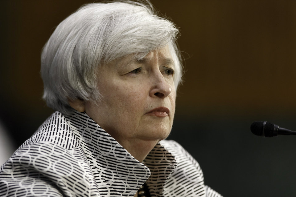 Photo - Federal Reserve Chair Janet Yellen listens as she testifies on Capitol Hill in Washington, Tuesday, July 15, 2014, before  the Senate Banking Committee. Yellen said Tuesday that the economic recovery is not yet complete and for that reason the Fed intends to keep providing significant support to boost growth and improve labor market conditions.  (AP Photo/J. Scott Applewhite)