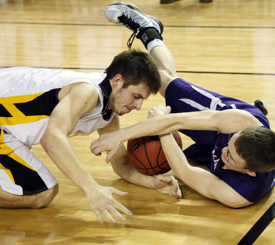 Photo - Arnett's Trevor Bryant (3), left, and Burlington's Reno Talbott (11) battle for a loose ball during a Class B Boys first-round game of the state high school basketball tournament between Burlington and Arnett at Jim Norick Arena, The Big House, on State Fair Park in Oklahoma City, Thursday, Feb. 28, 2013. Arnett won, 56-32. Photo by Nate Billings, The Oklahoman