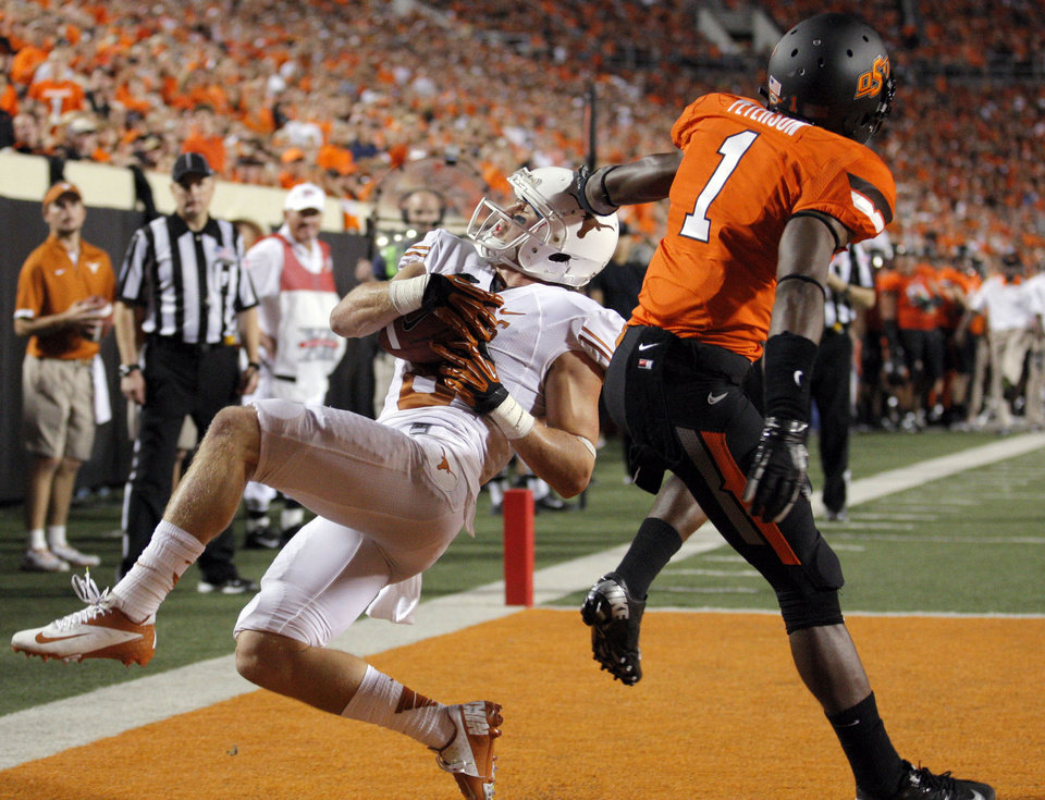 Texas\' Jaxon Shipley (8) makes a touchdown as Oklahoma State\'s Kevin Peterson (1) defends during a college football game between Oklahoma State University (OSU) and the University of Texas (UT) at Boone Pickens Stadium in Stillwater, Okla., Saturday, Sept. 29, 2012. Texas on 41-36. Photo by Sarah Phipps, The Oklahoman