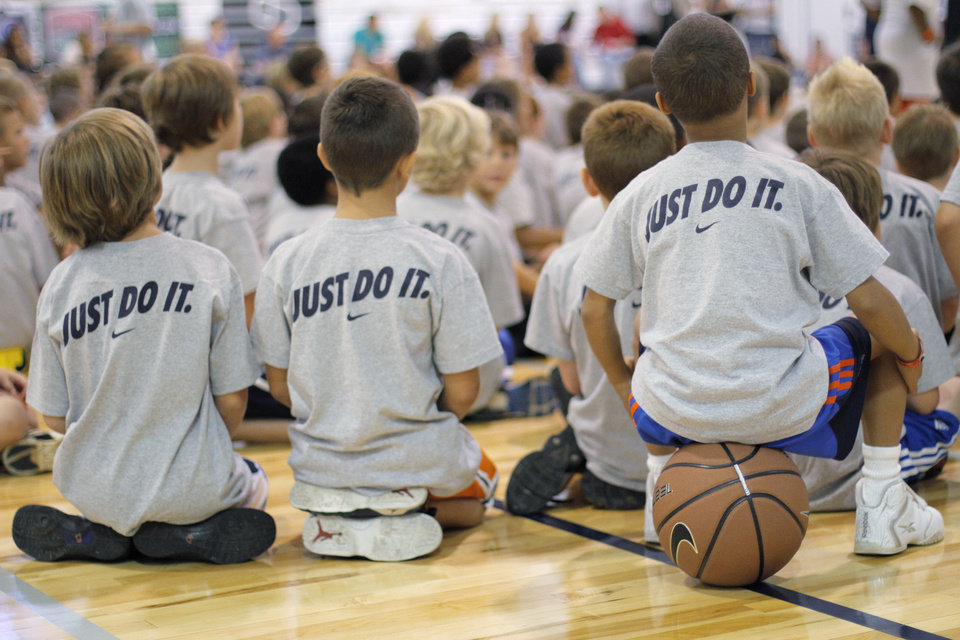 Camp participants listen to Kevin Durant speak during the second day of the Kevin Durant basketball camp at Heritage Hall in Oklahoma City, Thursday, June 30, 2011.  Photo by Garett Fisbeck, The Oklahoman