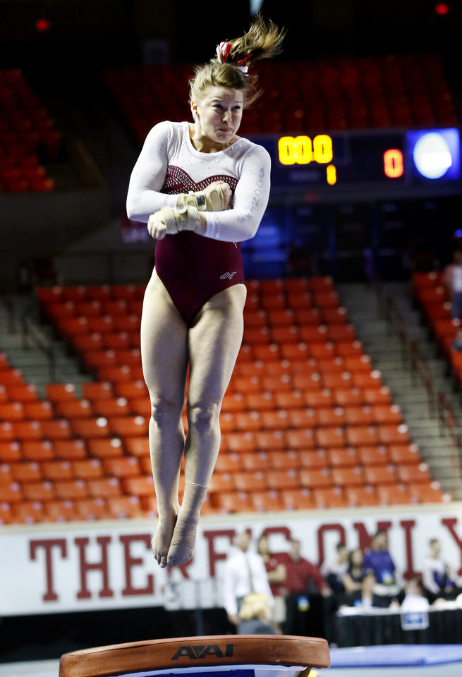 Keeley Kmieciak makes her vault as the University of Oklahoma Sooners (OU) compete at the NCAA, Women's Gymnastics Regional at The Lloyd Noble Center on Saturday, April 6, 2013  in Norman, Okla. Photo by Steve Sisney, The Oklahoman