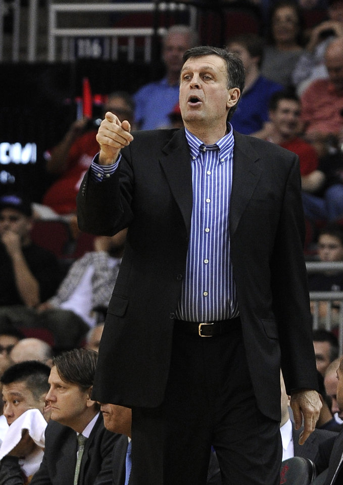 Houston Rockets coach Kevin McHale calls out to his players in the first half of an NBA basketball game against the Brooklyn Nets on Saturday, Jan. 26, 2013, in Houston. (AP Photo/Pat Sullivan)