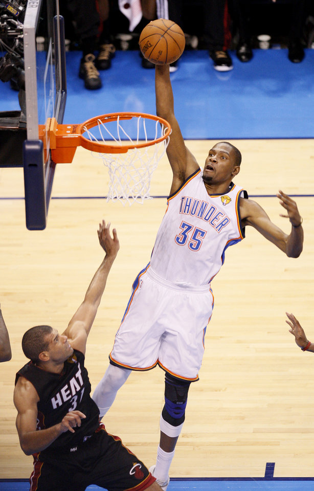 Oklahoma City's Kevin Durant (35) goes up for a dunk over Miami's Shane Battier (31) during Game 2 of the NBA Finals between the Oklahoma City Thunder and the Miami Heat at Chesapeake Energy Arena in Oklahoma City, Thursday, June 14, 2012. Photo by Nate Billings, The Oklahoman