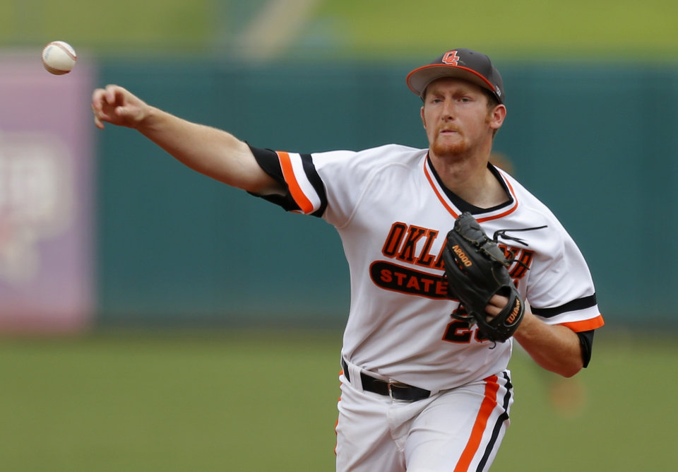 Photo - OSU's Trey Cobb pitches during a Big 12 Tournament baseball game between Oklahoma State University and the University of Texas at Chickasaw Bricktown Ballpark in Oklahoma City, Saturday, May 24, 2014. Photo by Bryan Terry The Oklahoman