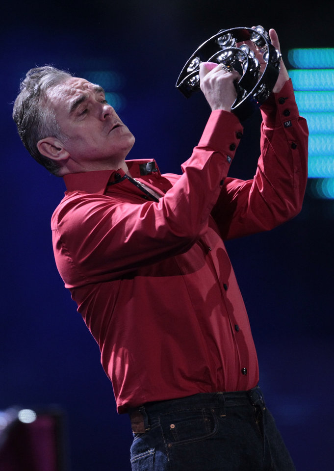 "Photo - FILE - In this Friday, Feb. 24, 2012 file photo, England's singer Morrissey performs at the 53rd annual Vina del Mar International Song Festival in Vina del Mar, Chile. Animal rights activist and singer Morrissey said he's canceled an appearance Tuesday, Feb. 26, 2013, on Jimmy Kimmel's talk show because cast members of A&E's ""Duck Dynasty"" also were scheduled to appear. (AP Photo/Jorge Saenz, File)"