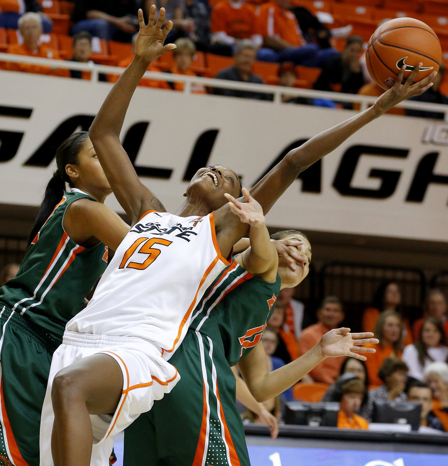 Oklahoma State\'s Toni Young (15) grabs the ball between Texas-Pan American\'s Taylor Cyphers (32) and Franchesca Simon (12) during a women\'s college basketball game between Oklahoma State University (OSU) and the University of Texas-Pan American at Gallagher-Iba Arena in Stillwater, Okla., Tuesday, Nov. 20, 2012. Photo by Bryan Terry, The Oklahoman