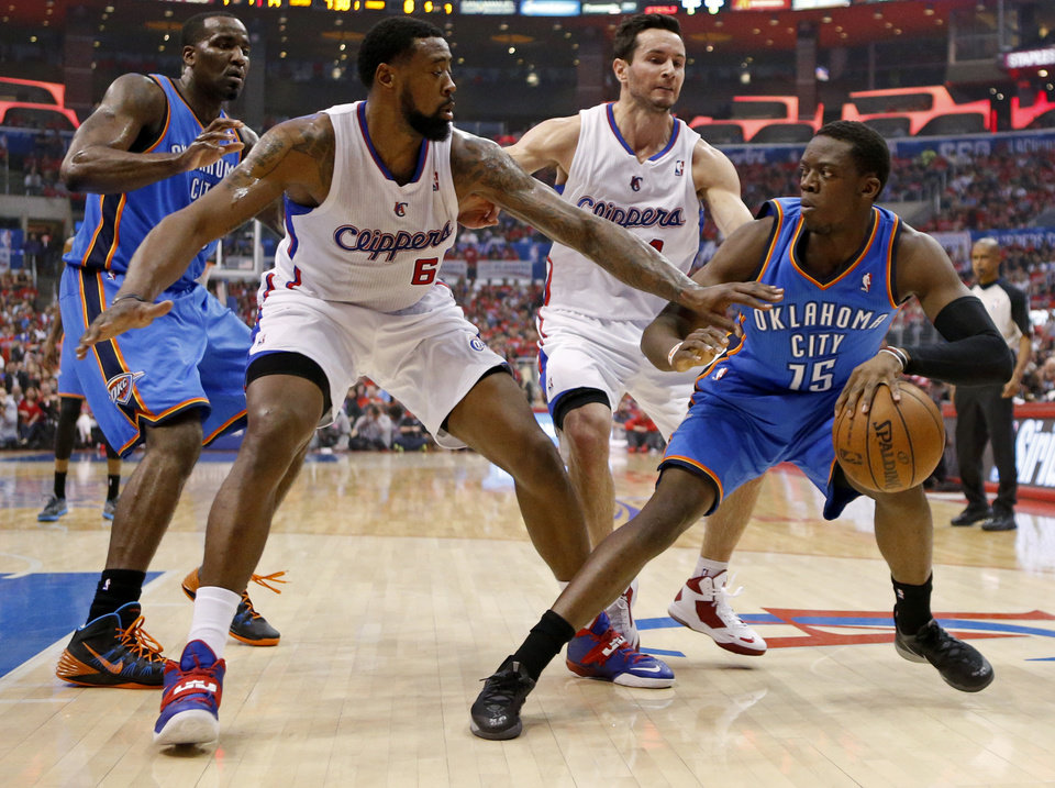 Photo - Oklahoma City's Reggie Jackson (15) dribbles beside Los Angeles' DeAndre Jordan (6) and J.J. Redick (4) as Oklahoma City's Kendrick Perkins (5) watches during Game 3 of the Western Conference semifinals in the NBA playoffs between the Oklahoma City Thunder and the Los Angeles Clippers at the Staples Center in Los Angeles, Friday, May 9, 2014. Photo by Nate Billings, The Oklahoman