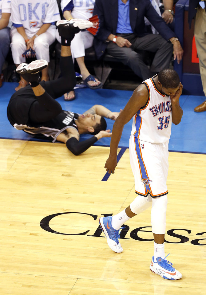 Photo - Oklahoma City's Kevin Durant (35) reacts after fouling San Antonio's Danny Green (4) on a 3-point shot during Game 6 of the Western Conference Finals in the NBA playoffs between the Oklahoma City Thunder and the San Antonio Spurs at Chesapeake Energy Arena in Oklahoma City, Saturday, May 31, 2014. Photo by Nate Billings, The Oklahoman