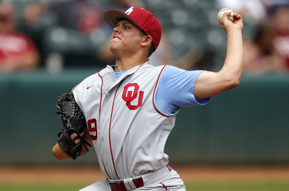 Photo - Oklahoma's Jake Fisher pitches against Kansas State during a Big 12 Championship tournament game at the Chickasaw Bricktown Ballpark in Oklahoma City, Saturday, May, 25, 2013. Oklahoma won 7-6. Photo by Bryan Terry, The Oklahoman
