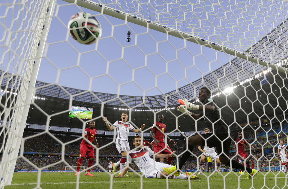 Photo - Germany's Miroslav Klose, centre, watches the ball into the net as he scores his side's second goal during the group G World Cup soccer match between Germany and Ghana at the Arena Castelao in Fortaleza, Brazil, Saturday, June 21, 2014. (AP Photo/Frank Augstein)