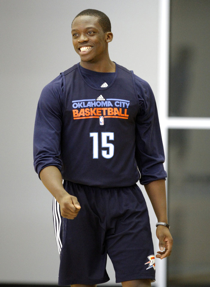 Photo - Oklahoma City's Reggie Jackson laughs  during the Thunder's practice in Oklahoma City, Sunday, Dec. 11, 2011. Photo by Sarah Phipps, The Oklahoman