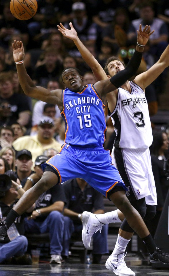 Photo - Oklahoma City's Reggie Jackson (15) leaps for the ball beside San Antonio's Marco Belinelli (3) during Game 1 of the Western Conference Finals in the NBA playoffs between the Oklahoma City Thunder and the San Antonio Spurs at the AT&T Center in San Antonio, Monday, May 19, 2014. Photo by Sarah Phipps, The Oklahoman