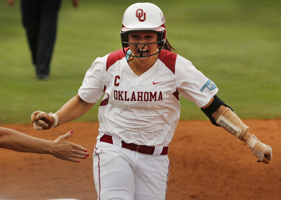 Photo -                    OU's Lauren Chamberlain rounds third after a home run off Tennessee pitcher Ellen Renfroe during Game 3 of the Norman Super Regional on Sunday. Chamberlain hit two home runs in the Sooners' 8-2 win, which sent them to the Women's College World Series.                                                                             Photo by Steve Sisney, The Oklahoman