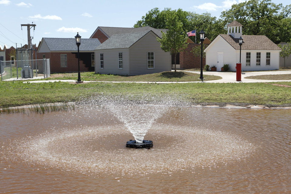 Photo - A fountain is one of the features used to teach safety at the Edmond Fire Department's Children's Safety Village, an educational center in Edmond, OK, Tuesday, April 27, 2010. By Paul Hellstern, The Oklahoman ORG XMIT: KOD