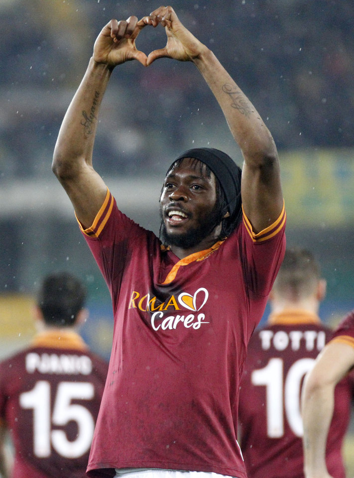 Photo - AS Roma forward Gervinho, of Ivory Coast, celebrates after scoring during a Serie A soccer match against Chievo at Bentegodi stadium in Verona, Italy, Saturday, March 22, 2014. (AP Photo/Felice Calabro')