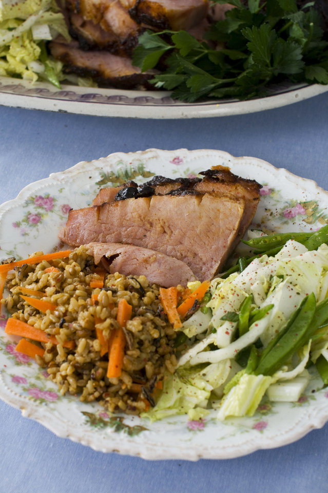 In this image taken on March 11, 2013, hoisin-glazed ham with Napa cabbage-snow pea slaw is shown served on a plate in Concord, N.H. (AP Photo/Matthew Mead) ORG XMIT: NYLS223