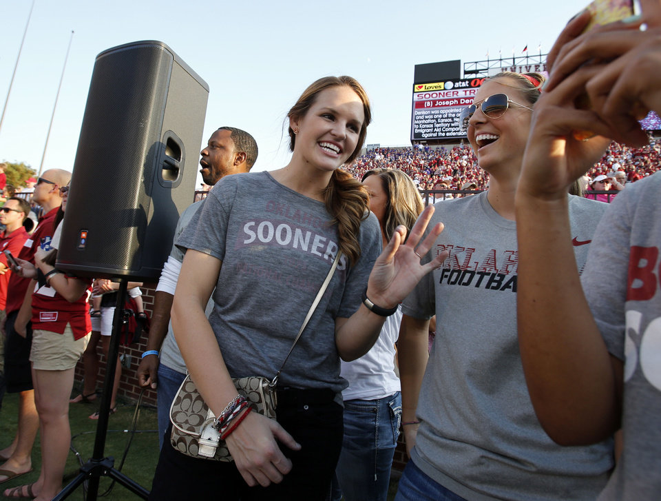 Whitney Hand waits near the end zone before a college football game between the University of Oklahoma Sooners (OU) and the Kansas State University Wildcats (KSU) at Gaylord Family-Oklahoma Memorial Stadium, Saturday, September 22, 2012. At right is fellow basketball teammate Morgan Hook.  Photo by Steve Sisney, The Oklahoman <strong>STEVE SISNEY - THE OKLAHOMAN</strong>