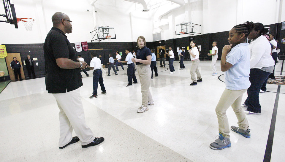 Martial arts instructor Ken Banks, at left, leads students Jan. 23 in a martial arts class taught by Police Athletic League staff members at Martin Luther King Elementary School in Oklahoma City. Photo by Paul B. Southerland, The Oklahoman