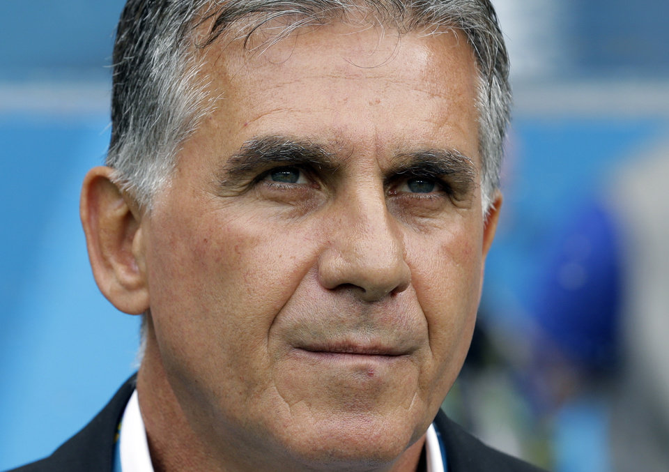 Photo - Iran's head coach Carlos Queiroz looks on before the group F World Cup soccer match between Bosnia and Iran at the Arena Fonte Nova in Salvador, Brazil, Wednesday, June 25, 2014. (AP Photo/Sergei Grits)