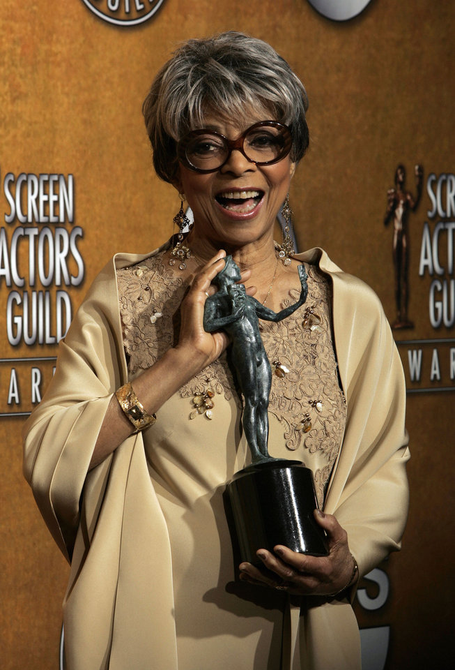Photo - FILE - In this Jan. 27, 2008 file photo, Ruby Dee poses with the award for outstanding performance by a female actor in a supporting role for her work in