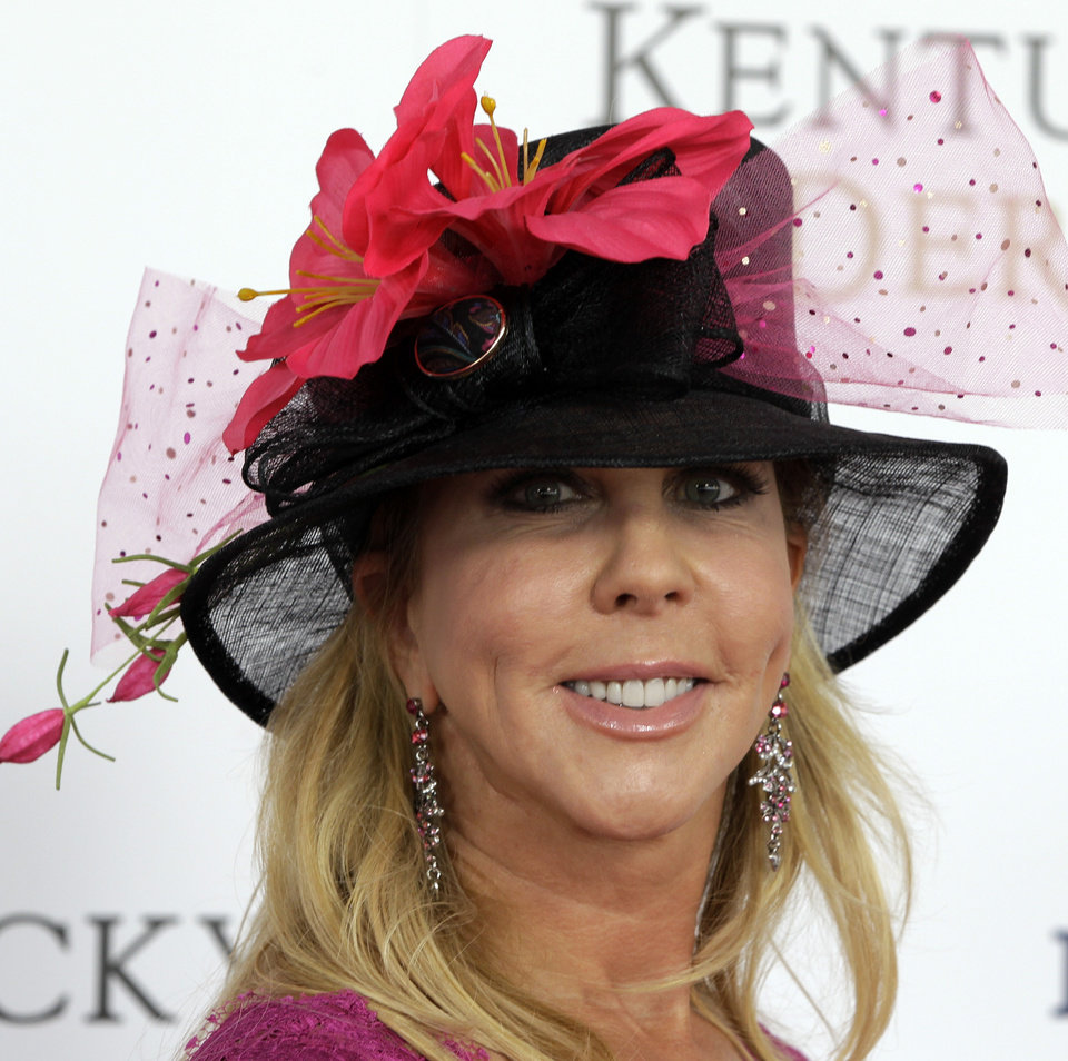 "Vicki Gunvalson, star of ""Real Housewives of Orange County"" arrives for the 138th Kentucky Derby horse race at Churchill Downs Saturday, May 5, 2012, in Louisville, Ky. (AP Photo/Darron Cummings)  ORG XMIT: DBY135"