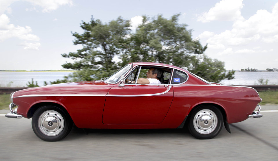 Photo -   Irv Gordon drives his Volvo P1800 in Babylon, N.Y., Monday, July 2, 2012. Gordon's car already holds the world record for the highest recorded milage on a car and he is less than 40,000 miles away from passing three million miles on the Volvo. (AP Photo/Seth Wenig)