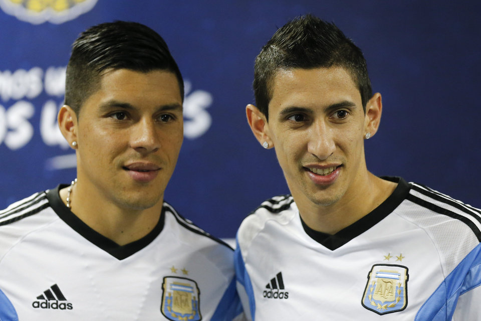 Photo - Argentina's Angel di Maria, right, and teammate Enzo Perez pose for photographers at the start of a news conference in Vespesiano, near Belo Horizonte, Brazil, Sunday, June 22, 2014.  Argentina plays in group F of the 2014 soccer World Cup. (AP Photo/Victor R. Caivano)