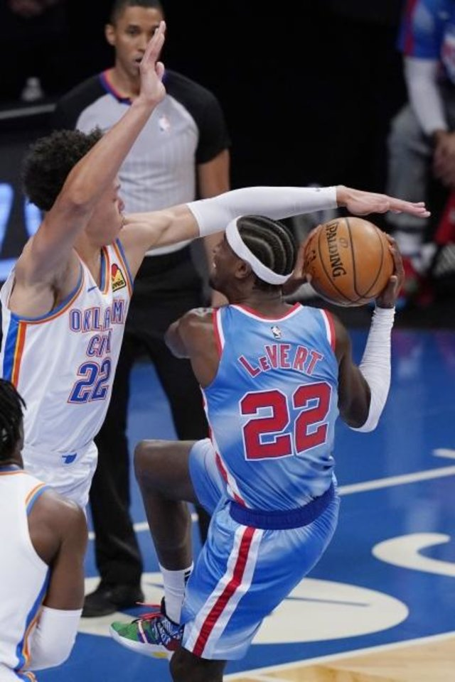 Photo -  Oklahoma City Thunder forward Isaiah Roby (22) tries to block Brooklyn Nets guard Caris LeVert as LeVert prepares to go for a layup during the Sunday's game in New York. [AP Photo/Kathy Willens]