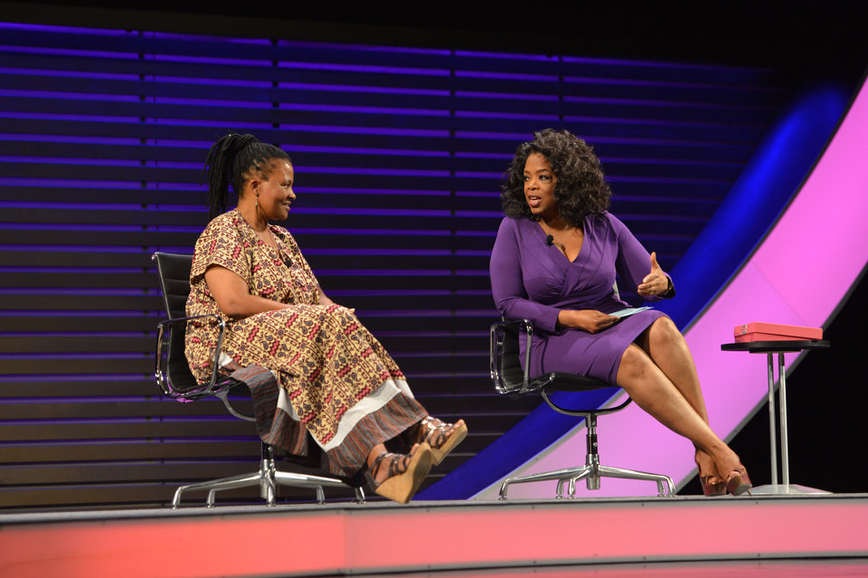 Photo - This image released by the  Women in the World Conference  shows scholar, humanitarian and founder of the Tinogona Foundation Dr. Tererai Trent, left, OWN CEO Oprah Winfrey, during a panel discussion called