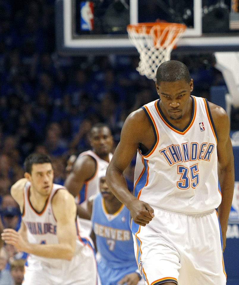 Photo - Oklahoma City's Kevin Durant and his teammates run back downcourt after Durant hit a three pointer against Denver during the first round NBA Playoff basketball game between the Thunder and the Nuggets at OKC Arena in downtown Oklahoma City on Wednesday, April 20, 2011. Photo by John Clanton, The Oklahoman